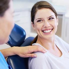 dentist holding woman's shoulder